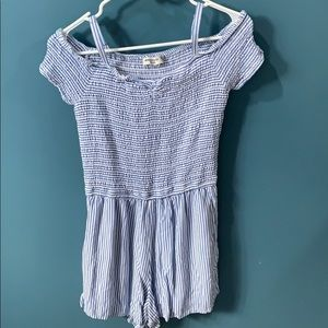 A light blue and white striped romper